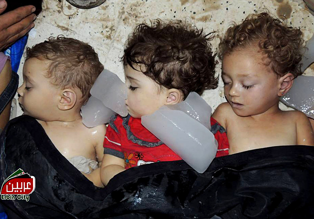 . This citizen journalism image provided by the Local Committee of Arbeen which has been authenticated based on its contents and other AP reporting, shows dead bodies of Syrian children in Arbeen town, Damascus, Syria, Wednesday, Aug. 21, 2013.  (AP Photo/Local Committee of Arbeen)