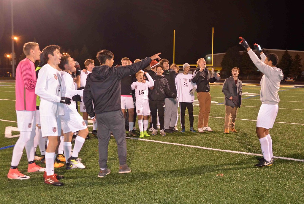 . Paul DiCicco - The News-Herald University sings its alma mater to celebrate a 7-1 win Oct. 28.