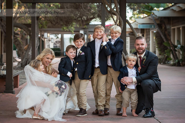 portrait of bride, groom and kids at San Diego Marina Village