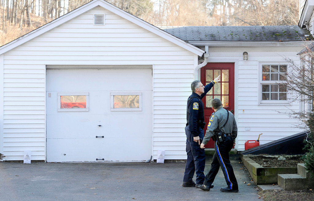 . Law enforcement canvass an area nearby a school shooting at the Sandy Hook Elementary School in Newtown, Conn., about 60 miles (96 kilometers) northeast of New York City, Friday, Dec. 14, 2012. An official with knowledge of Friday\'s shooting said 27 people were dead, including 18 children. (AP Photo/Jessica Hill)
