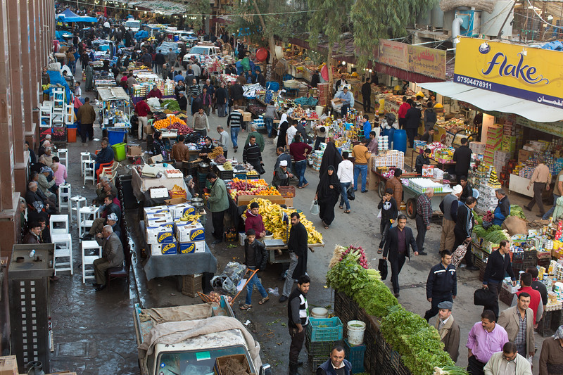 Row of stalls and crowds of shooped at the Erbil souq.