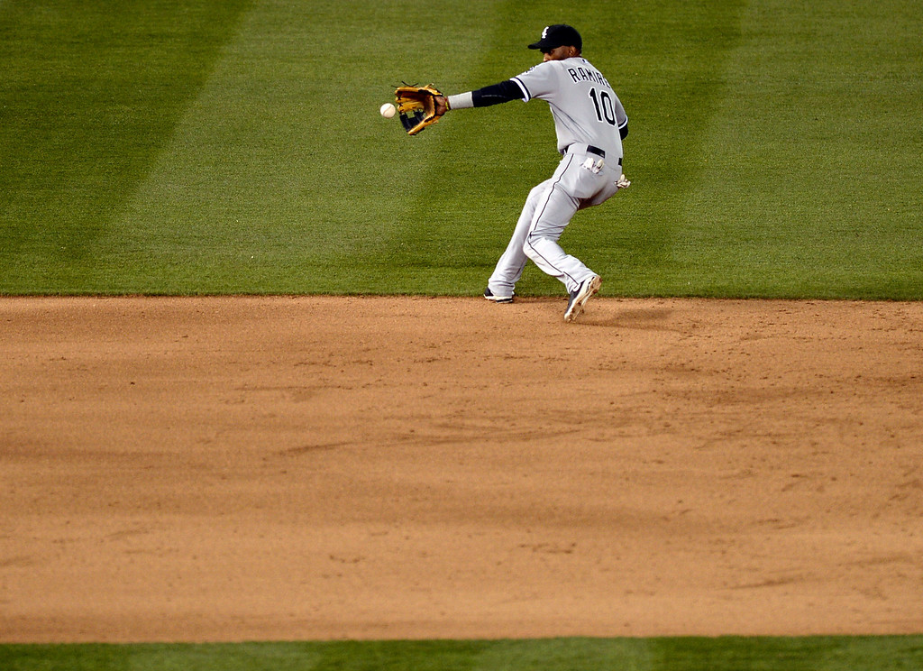 . Chicago shortstop Alexei Ramirez went deep in the hole to retire Colorado bate Michael Cuddyer in the sixth inning. The Chicago White Sox clobbered the Colorado Rockies 15-3 Tuesday night, April 8, 2014 at Coors Field in Denver.  (Photo by Karl Gehring/The Denver Post)