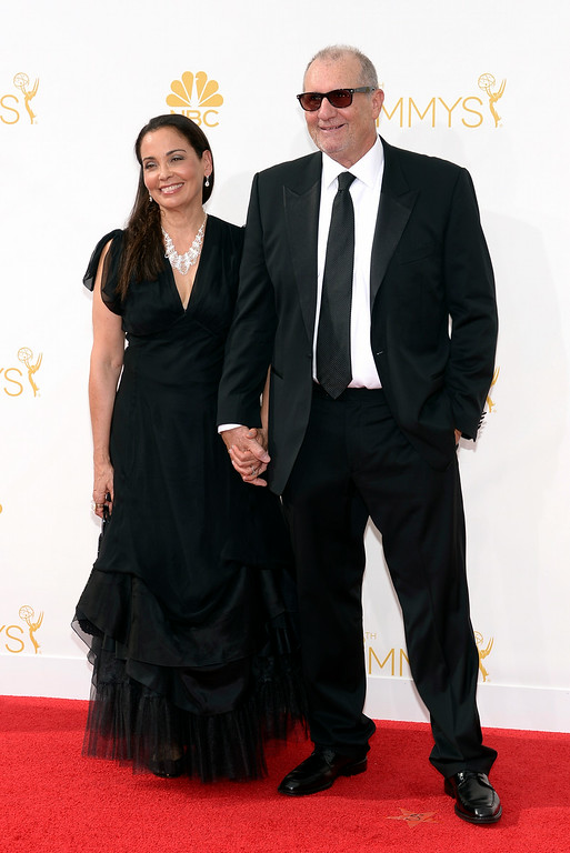 . Catherine Rusoff (L) and Ed O\'Neill on the red carpet at the 66th Primetime Emmy Awards show at the Nokia Theatre in Los Angeles, California on Monday August 25, 2014. (Photo by John McCoy / Los Angeles Daily News)