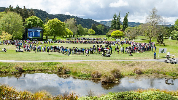 Golf fans surround the 18th green to watch Yuxin Lin from China win the Asia-Pacific Amateur Championship tournament 2017 held at Royal Wellington Golf Club, in Heretaunga, Upper Hutt, New Zealand from 26 - 29 October 2017. Copyright John Mathews 2017.   www.megasportmedia.co.nz