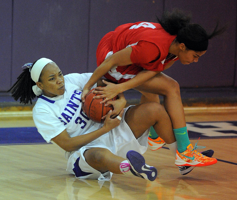 . LONG BEACH - 02/20/13 - (Photo: Scott Varley, Los Angeles Newspaper Group)  Serra and St. Anthony meet in the Quarterfinals of the Division 4AA CIF-SS girls basketball playoffs. St. Anthony\'s Jordan Hixon, left, fouls Deandrea Toler as they both go after a loose ball.