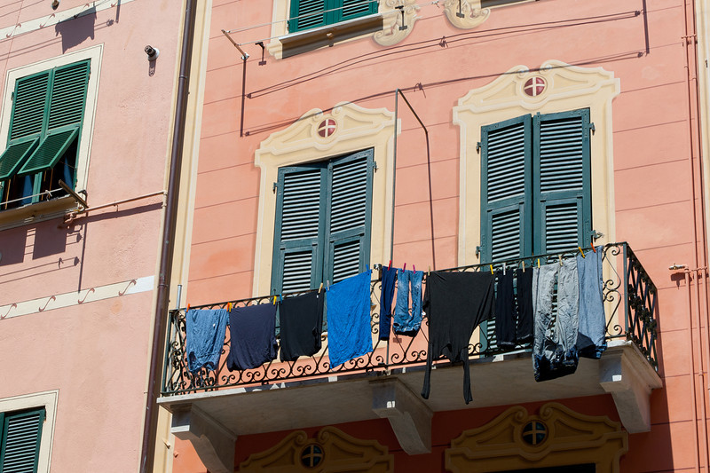 Clothes hung to dry in a balcony - Cinque Terre, Italy