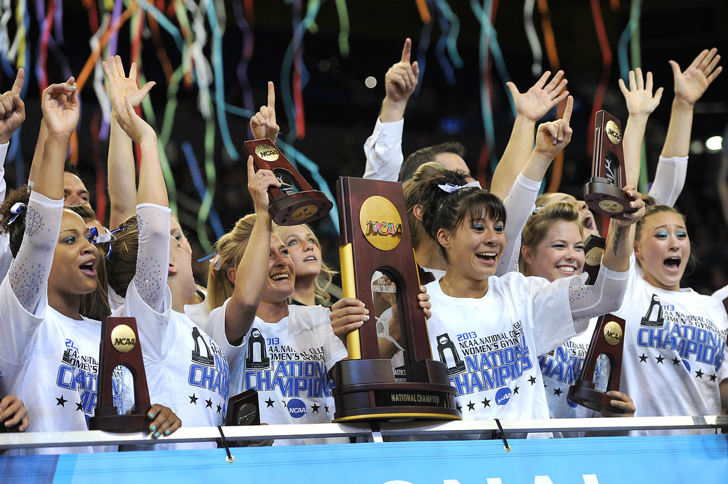 . The Florida gymnastics team celebrates winning the NCAA Women\'s Gymnastics Championship Team Finals at Pauley Pavilion, Saturday, April 20, 2013. (Michael Owen Baker/Staff Photographer)