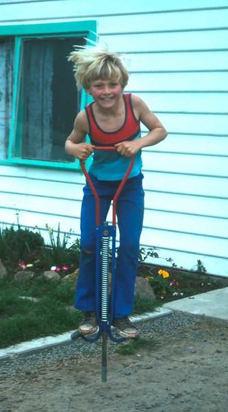 1977-8 (14) Andrew 8 yrs on pogo stick.jpg
