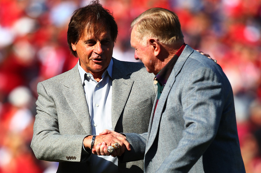 . ST LOUIS, MO - OCTOBER 12:  Tony La Russa (L) and Red Schoendienst shake hands after throwing out the ceremonial first pitch prior to Game Two of the National League Championship Series between the St. Louis Cardinals and the Los Angeles Dodgers at Busch Stadium on October 12, 2013 in St Louis, Missouri.  (Photo by Dilip Vishwanat/Getty Images)