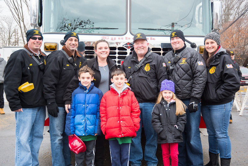 Cheif Carl Lengel, Michael Brooks with his wife Liz and his daughter Alison, Bill Abrams, Cheif Nick Pearsall with his wife Shannan and his sons Aidan and Nolan.jpg