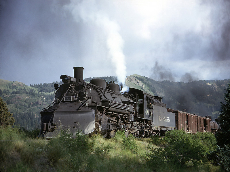 July 23, 1963. An afternoon Cumbres turn with 484 on the point blows for the Coxo crossing on the old dirt road from Chama to Cumbres. A helper is cut in ahead of the caboose.
