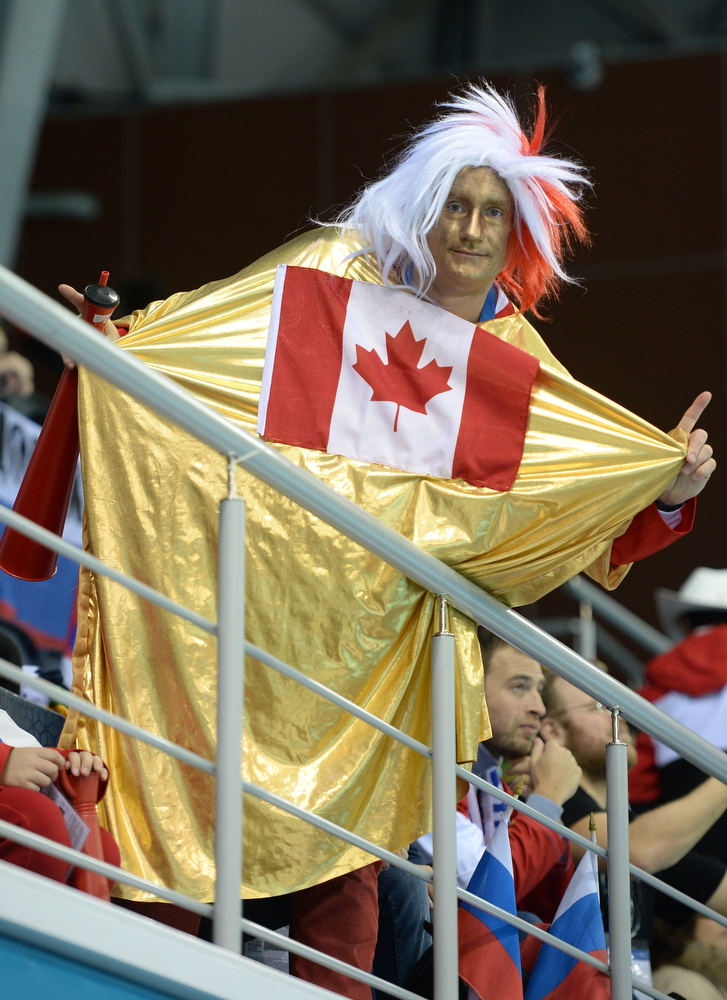 . A canadian supporter cheers during the Women\'s Curling Gold Medal Game Sweden vs Canada at the Ice Cube Curling Center during the Sochi Winter Olympics on February 20, 2014. JUNG YEON-JE/AFP/Getty Images