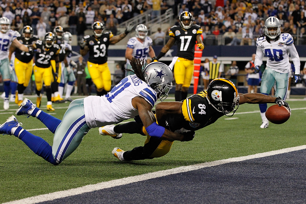 . Antonio Brown #84 of the Pittsburgh Steelers dives across the goal line to score a touchdown against Mike Jenkins #21 of the Dallas Cowboys at Cowboys Stadium on December 16, 2012 in Arlington, Texas.  (Photo by Tom Pennington/Getty Images)