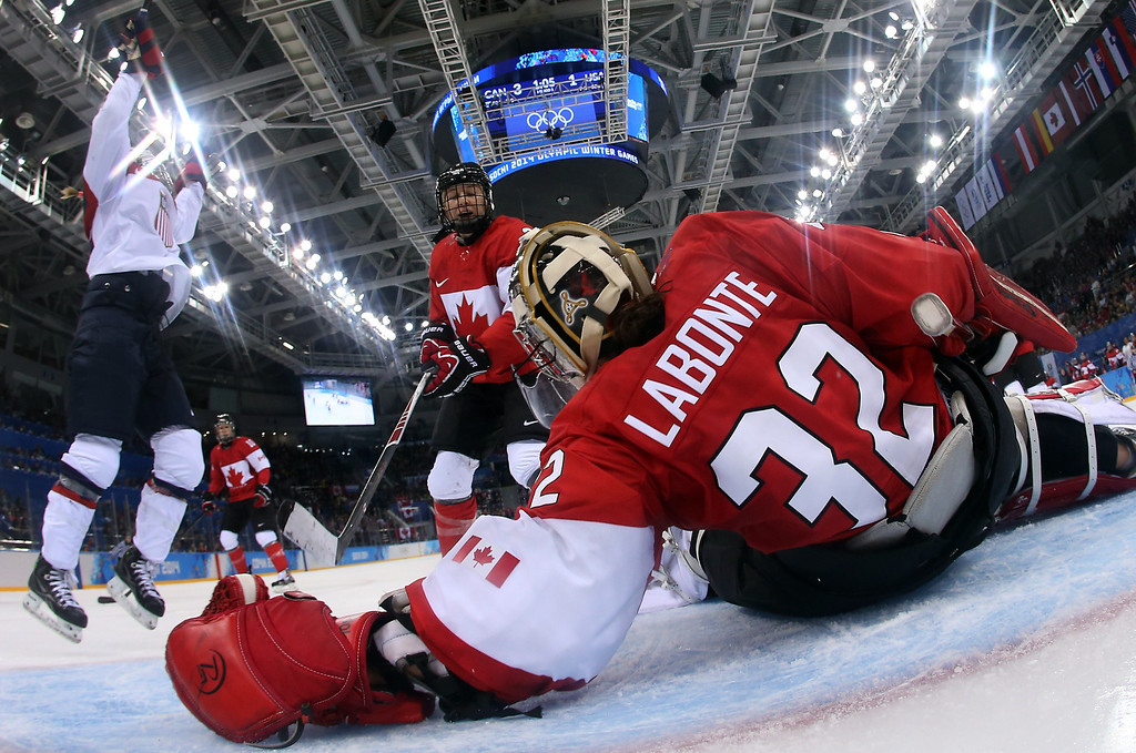 . Canada\'s goalkeeper Charline Labonte lies on the ice after USA scored a goal during the Women\'s Ice Hockey Group A match between Canada and USA at the Sochi Winter Olympics on February 12, 2014 at the Shayba Arena. AFP PHOTO / POOL / BRUCE  BENNETT/AFP/Getty Images