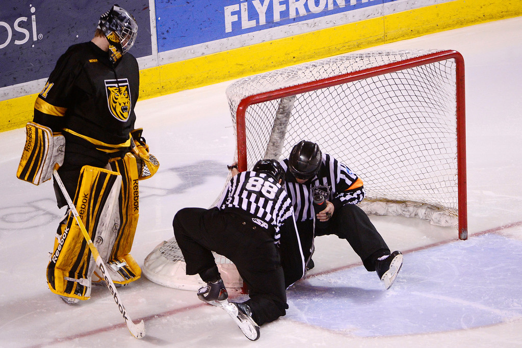 . DENVER, CO - MARCH 17: Joe Howe (31) of the Colorado College Tigers supervises as the refs adjust his goal during the third period of action. The University of Denver loses 4-3 to Colorado College during the WCHA playoffs at Magness Arena. (Photo by AAron Ontiveroz/The Denver Post)