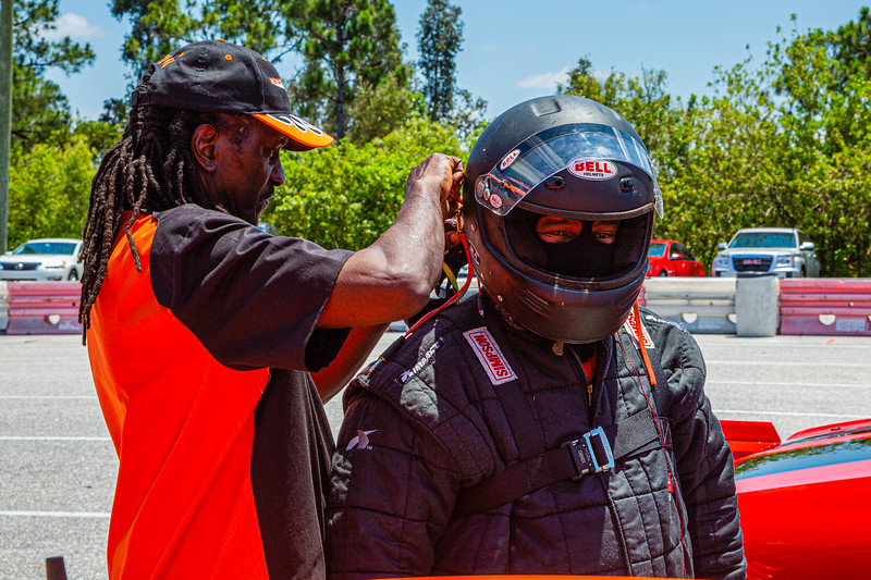 John Felton (left) secures the helmet of Johnny Lee Hollis Sr. before Hollis climbs into his drag car at the Super Chevy Show at Palm Beach International Raceway in Jupiter, Florida on Saturday, May 25, 2019. JOSEPH FORZANO/palmbeachpost.com]