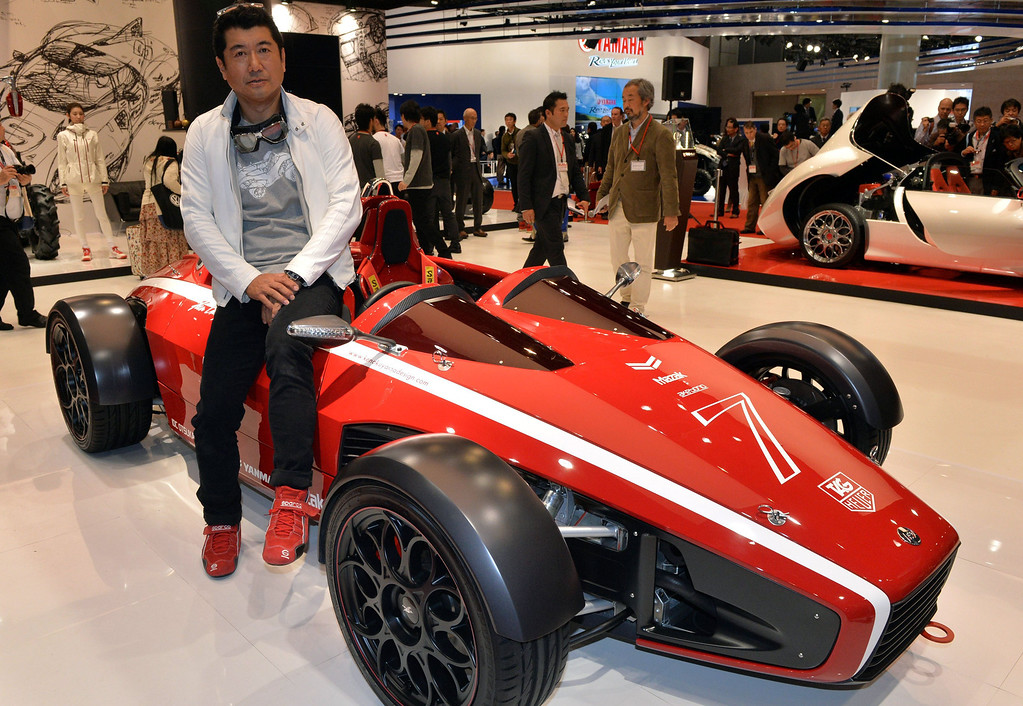 """. Japanese car designer Ken Okuyama, who designed a Ferrari car, displays the formula car designed \""""Kode 7\"""", equipped with a 1.6-litter engine to drive two-seater body which will be priced 8.5 million yen (85,000 USD) at the press preview of the Tokyo Motor Show in Tokyo on November 20, 2013. The 43rd Tokyo Motor Show runs until December 1, and features 177 exhibitors including parts suppliers from a dozen countries. .   AFP PHOTO / Yoshikazu TSUNO/AFP/Getty Images"""