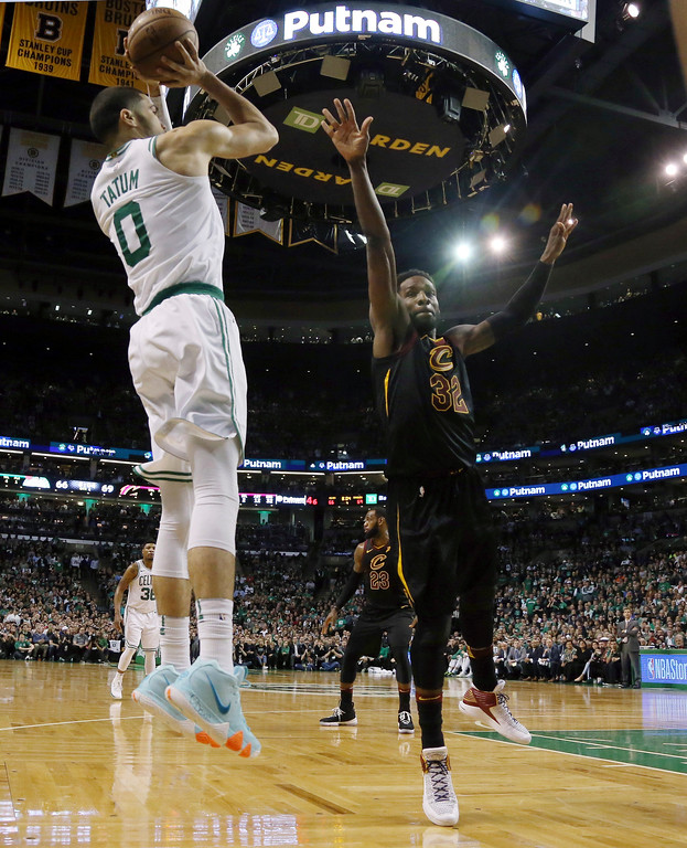 . Boston Celtics forward Jayson Tatum (0) shoots the ball against Cleveland Cavaliers forward Jeff Green (32) during the second half in Game 7 of the NBA basketball Eastern Conference finals, Sunday, May 27, 2018, in Boston. (AP Photo/Elise Amendola)