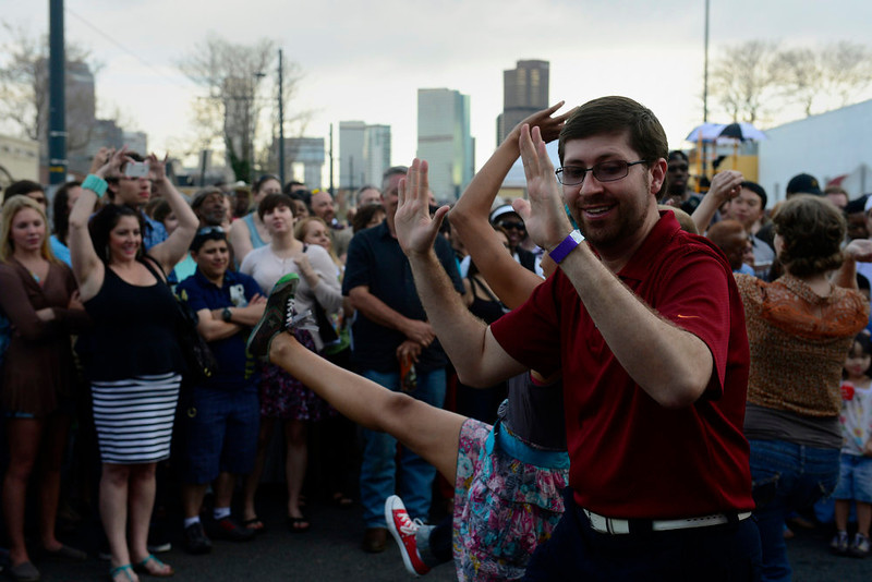 . Peter Capra, of Denver, dances as part of a swing dance flash mob put on by Community-Minded Dance at the beginning of the first set by the Hazel Miller Band, the headlining band at the Five Points Jazz Festival, May 18, 2013. The festival ran 11am to 8pm on May 18, 2013 and is a free community event highlighting local musicians, art and the historic Denver Five Points neighborhood.  (Photo By Mahala Gaylord/The Denver Post)