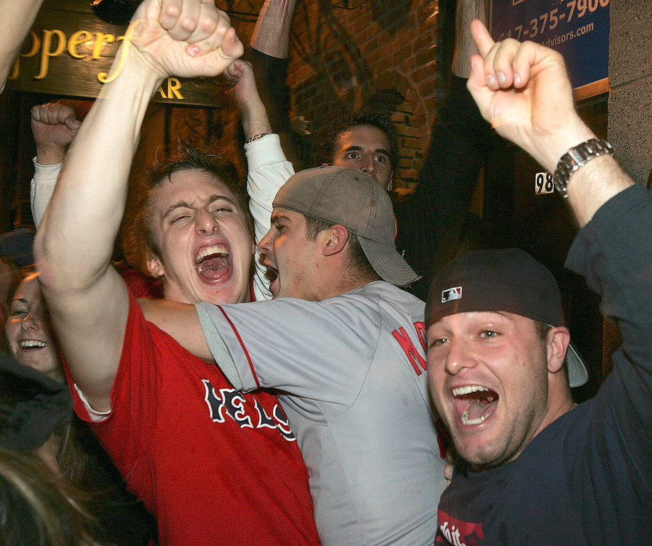 . Boston Red Sox fans celebrate in the street near Fenway Park in Boston after the Red Sox beat the St. Louis Cardinals in the World Series, Wednesday, Oct. 27, 2004. . (AP  Photo/Michael Dwyer)