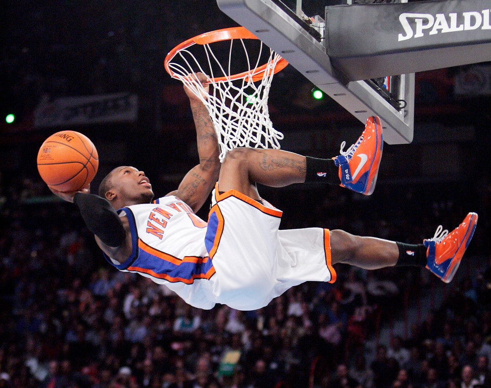 . Nate Robinson, of the New York Knicks, tries to dunk the ball during the the slam dunk contest at NBA Saturday Night, a part of NBA All-Star weekend in Las Vegas in this Feb. 17, 2007, file photo. Gerald Green won the contest. (AP Photo/Mark J. Terrill)