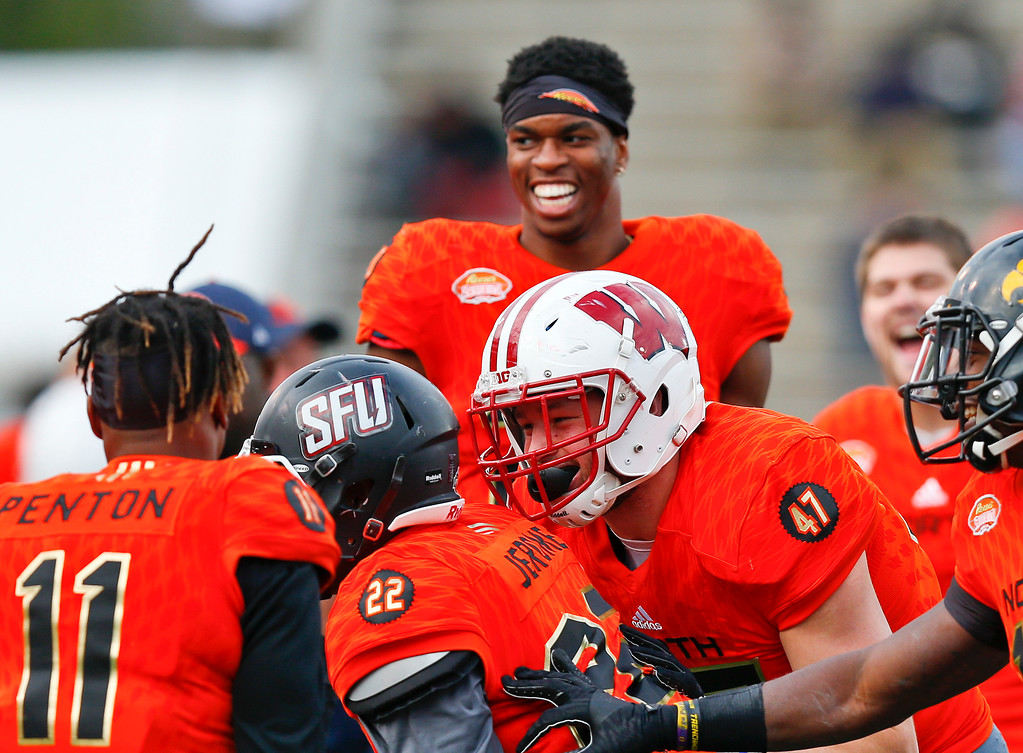 . North outside linebacker Vince Biegel (47), of Wisconsin, celebrates with North safety Lorenzo Jerome (22), of Saint Francis, Pa., after Jerome intercepted the ball during the second half of the Senior Bowl college football game, Saturday, Jan. 28, 2017, at Ladd�Peebles Stadium, in Mobile, Ala. The South won 16-15. (AP Photo/Brynn Anderson)