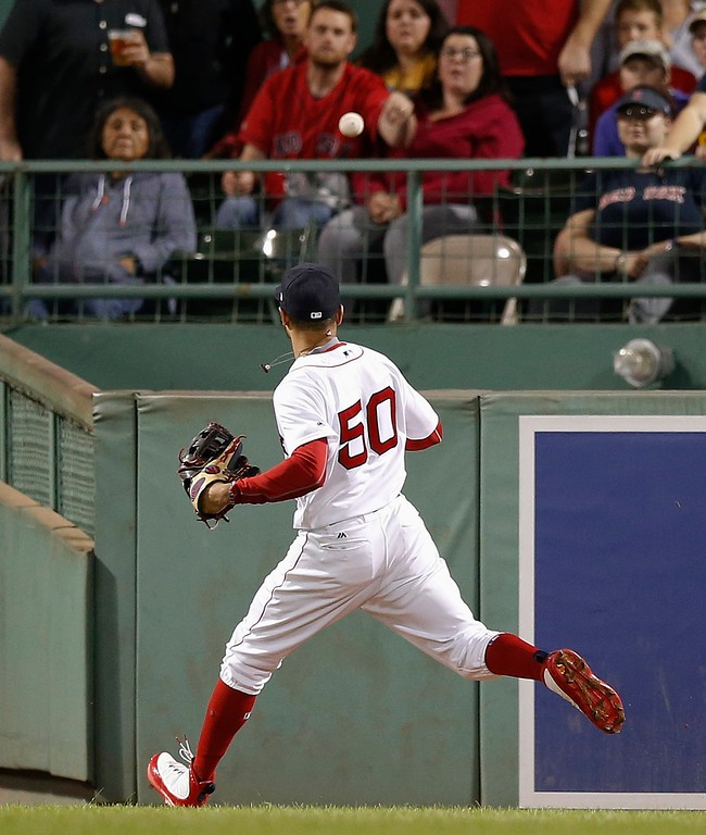 . Boston Red Sox\'s Mookie Betts watches the solo home run by Cleveland Indians\' Melky Cabrera during the sixth inning of a baseball game in Boston, Tuesday, Aug. 21, 2018. (AP Photo/Michael Dwyer)