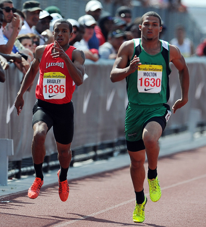 . Lakewood\'s Amir Bradley, left, along with Hilltop\'s Donald Molton competes in the 200 meters race in the during the Arcadia Invitational at Arcadia High School on Saturday, April 6, 2013 in Arcadia, Calif.  (Keith Birmingham Pasadena Star-News)