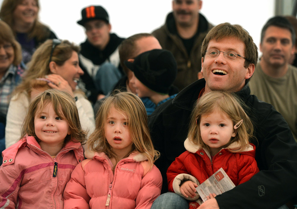 """. James Beeby and his daughters (l-r) Emma, Mia and Lily enjoy a performance by Duane Reichert in his one man act, Backstage with a Rodeo Clown, at the National Western Stock Show in Denver, CO, January, 26, 2013. Reichert says he\'s been a rodeo clown for 5 decades and started at age 19. Reichert used to get an adrenaline rush protecting cowboys from bulls he said, \""""now I get the same rush from making people laugh.\""""  (Photo By Craig F. Walker / The Denver Post)"""