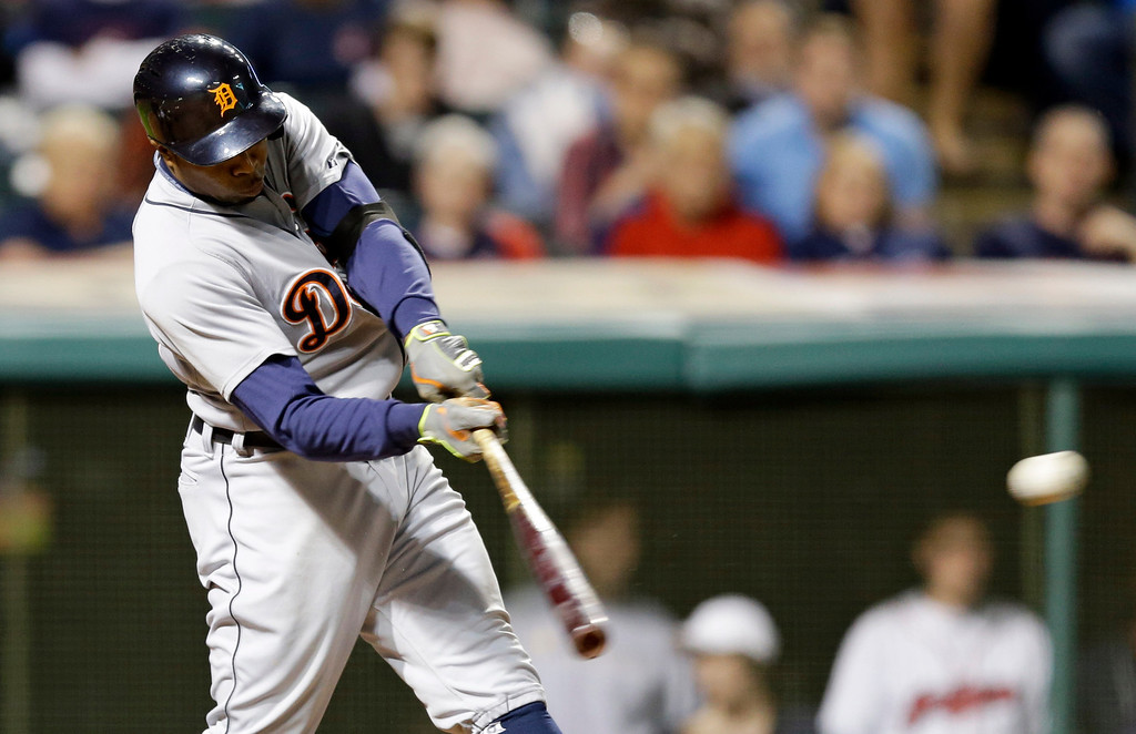 . Detroit Tigers\' Rajai Davis hits a two-RBI double off Cleveland Indians starting pitcher Corey Kluber in the seventh inning of a baseball game, Monday, May 19, 2014, in Cleveland. Nick Castellanos and Alex Avila scored. (AP Photo/Tony Dejak)