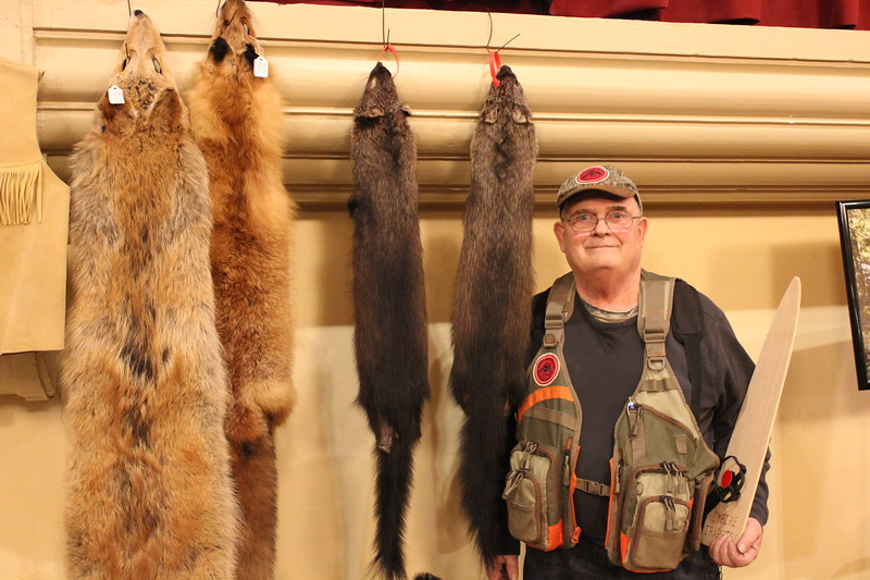 Charles Pritchard - Oneida Daily Dispatch Larry Chrysler of the Camden Empire Trappers club shows off two fox pelts and two fisher-cat pelts he's trapped at the CNY Sportsman Show  on Feb. 3, 2018