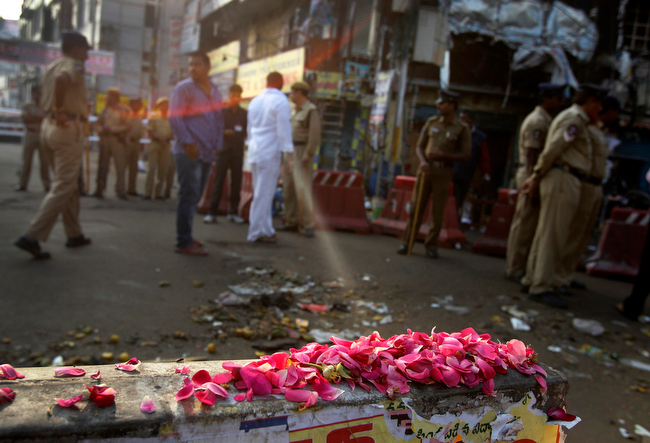 . Flowers are placed in memory of those killed, at one of the two bomb blast sites, in Hyderabad, India, Friday, Feb. 22, 2013. A day after two bicycle bombs killed more than a dozen people and wounded more than 100, investigators into India\'s worst bombing in more than a year searched Friday for possible links to anger over the execution of a Muslim militant. (AP Photo/Aijaz Rahi)