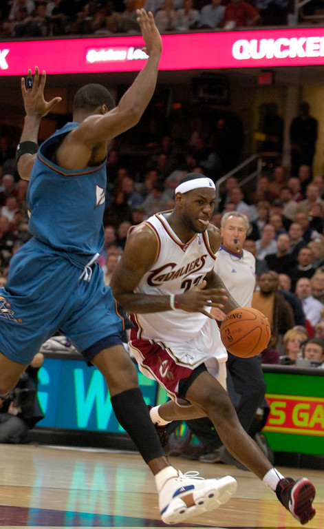. Lebron James drives towards the basket in the second period of Wednesday\'s opener against the Wizards.