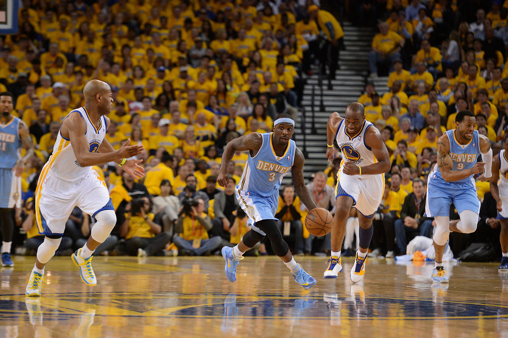 . OAKLAND, CA. - APRIL 26: Ty Lawson (3) of the Denver Nuggets pushes the ball up court after a steal on Jarrett Jack (2) of the Golden State Warriors during the second quarter in game 3 of the first round of the NBA Playoffs April 26, 2013 at Oracle Arena.  (Photo By John Leyba/The Denver Post)