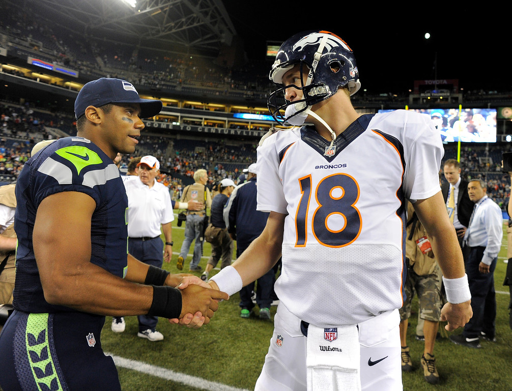 . SEATTLE, WA. - AUGUST 17: Denver Broncos quarterback Peyton Manning (18) shakes hands with Seattle Seahawks quarterback Russell Wilson (3) after the game August 17, 2013 at Century Link Field. (Photo By John Leyba/The Denver Post)