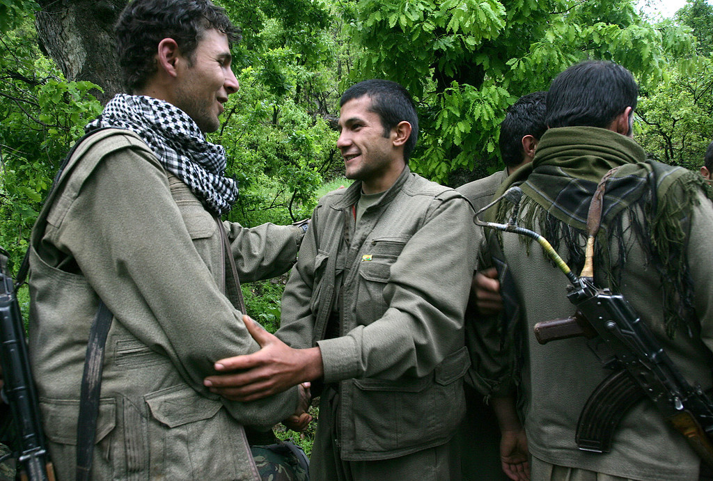 . Kurdish fighters from the Kurdistan Workers Party (PKK) congratulate each other after arriving in the Heror area, northeast of Dahuk, 260 miles (430 kilometers) northwest of Baghdad, Iraq, Tuesday, May 14, 2013. The first of Kurdish fighters from Turkey have entered northern Iraq as part of a peace deal to end a long uprising, despite Iraqi objections to the transfer. Comrades greeted 13 armed men and women from the Kurdistan Workers Party (PKK) at a ceremony in Heror in Iraq\'s self-ruled Kurdish area. The central government in Baghdad has rejected the deal, warning that the entry of more armed Kurdish fighters could harm the country\'s security. (AP Photo/ Ceerwan Aziz)