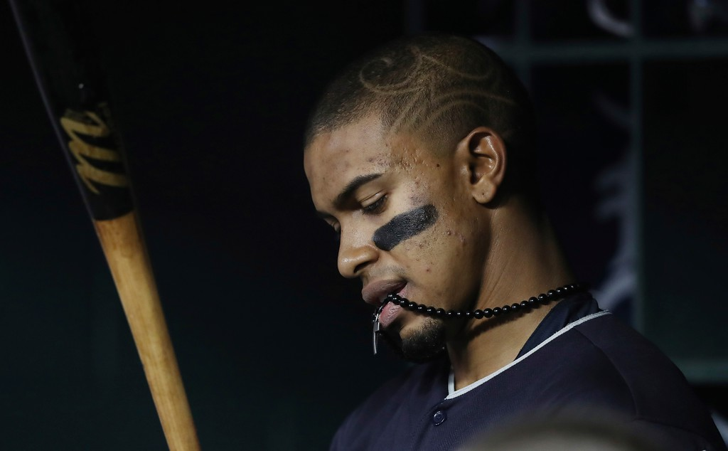 . Cleveland Indians shortstop Francisco Lindor looks over his bat in the dugout during the seventh inning of a baseball game against the Detroit Tigers, Tuesday, May 15, 2018, in Detroit. (AP Photo/Carlos Osorio)
