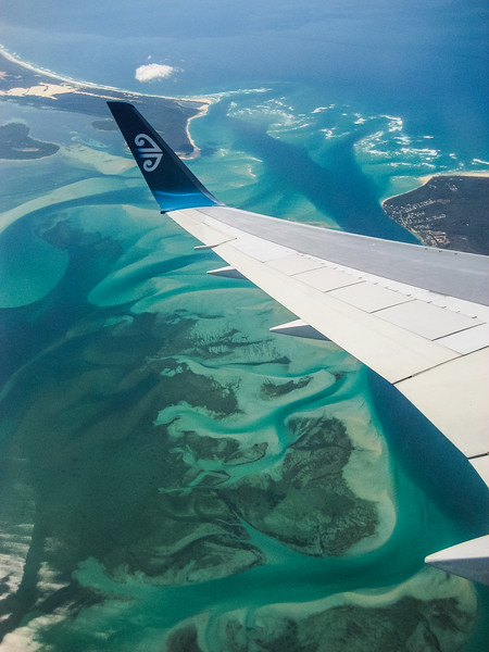 The tip of an air New Zealand airplane wing seen above the beautiful bays of Australia - , Lamb Island, Queensland, Australia (AU)