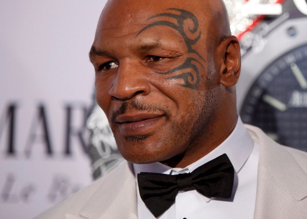 . Former heavyweight boxing champion Mike Tyson arrives to the American Theatre Wing\'s annual Tony Awards in New York June 9, 2013. REUTERS/Carlo Allegri