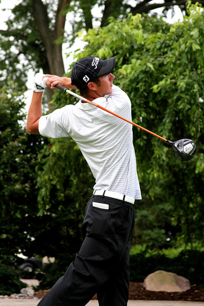 Ethan Tracy, 21, of Hilliard, Ohio, tees off in his match against Derek Ernst Friday morning.