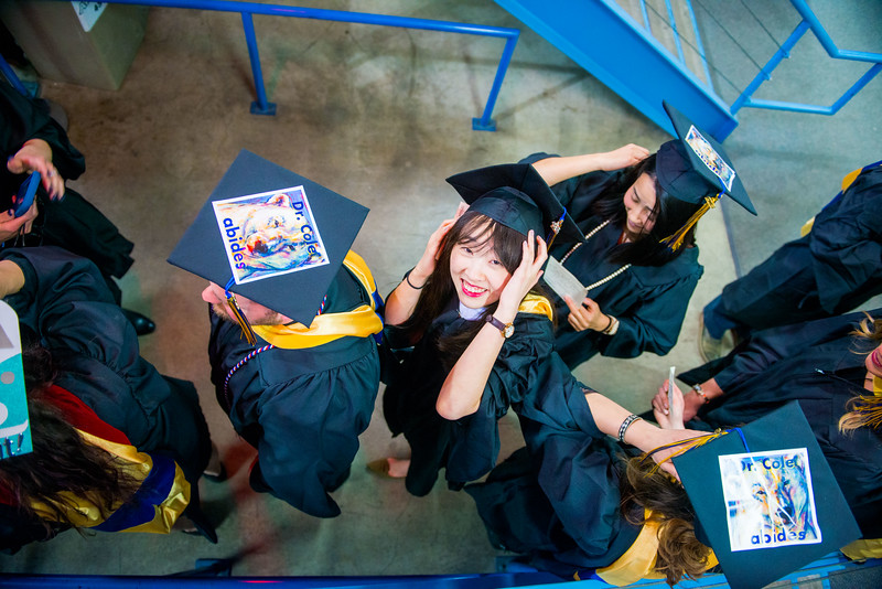 Yu Cao, a master's student in Arctic and Northern studies, waits in line during UAF's 2018 commencement ceremony at the Carlson Center on May 5, 2018.
