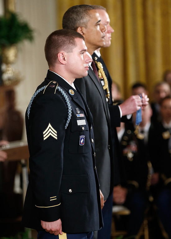 . U.S. President Barack Obama (C) stands with U.S. Army Sgt. Kyle J. White (L) before awarding him the Medal of Honor during a ceremony in the East Room of the White House May 13, 2014 in Washington, DC.   (Photo by Win McNamee/Getty Images)