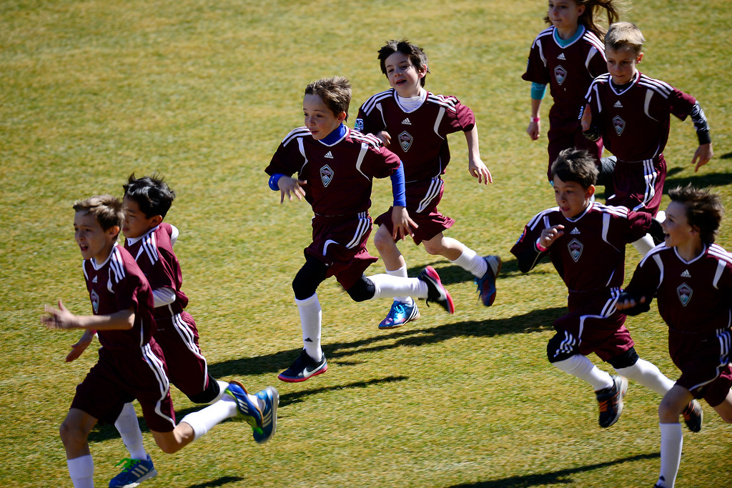 . COMMERCE CITY, CO - MARCH 10: Children run across the field during pre-game ceremonies. The Colorado Rapids play the Philadelphia Union at Dick\'s Sporting Goods Park. (Photo By AAron Ontiveroz/The Denver Post)