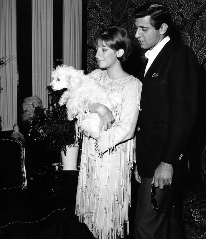 ". Joe Namath, New York Jets quarterback, visits actress-singer Barbra Streisand backstage at the Winter Garden Theater in New York City, Sept. 15, 1965.  Streisand, holding her pet poodle Sadie, is starring in the Broadway musical ""Funny Girl.\""  (AP Photo)"