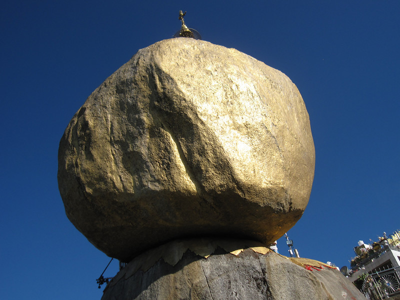 Kyaiktiyo, the Golden Rock, looks like it should fall off the side of the mountain in Burma.