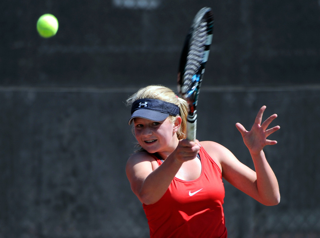 . Rebecca Weissmann from Loveland High School returns the ball to Madison Porter from Legend High School in the #1 Singles Bracket. (Photo By Kathryn Scott Osler/The Denver Post)