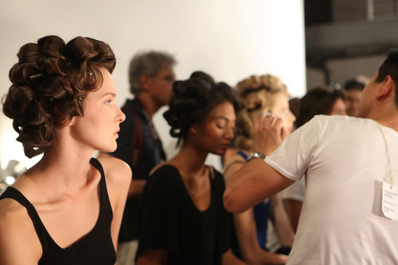 NEW YORK, NY - SEPTEMBER 07:  A model prepares backstage at the Billy Reid spring 2013 fashion show during Mercedes-Benz Fashion Week at Eyebeam on September 7, 2012 in New York City.  (Photo by Chelsea Lauren/Getty Images)