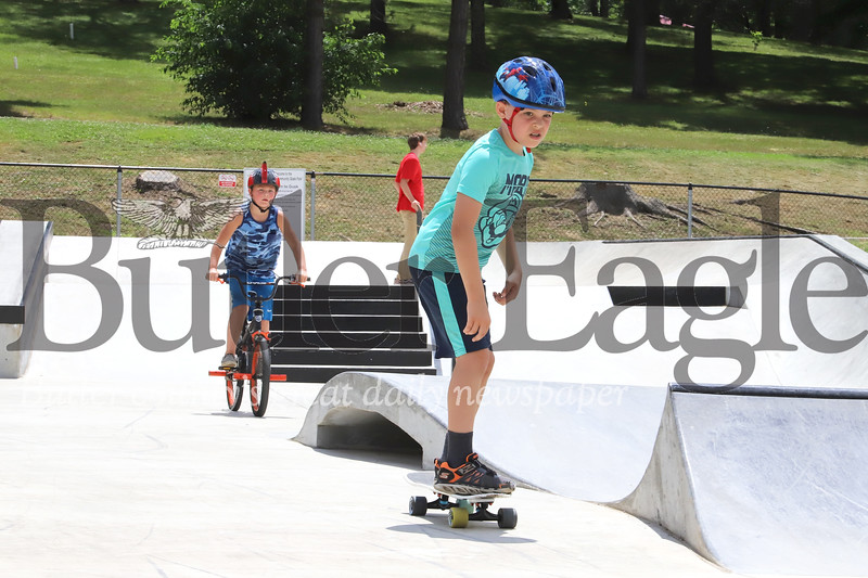 Leo Pedicone, 9, of Seven Fields skates through the Zelienople Memorial Skate Park with Dean Miganelli, 7, of Zelienople Tuesday. Seb Foltz/Butler Eagle