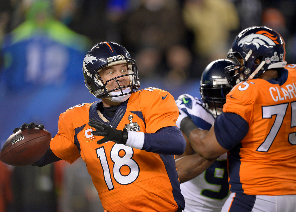 . Denver Broncos quarterback Peyton Manning (18) throwing during the fourth quarter. The Denver Broncos vs the Seattle Seahawks in Super Bowl XLVIII at MetLife Stadium in East Rutherford, New Jersey Sunday, February 2, 2014. (Photo by John Leyba/The Denver Post)
