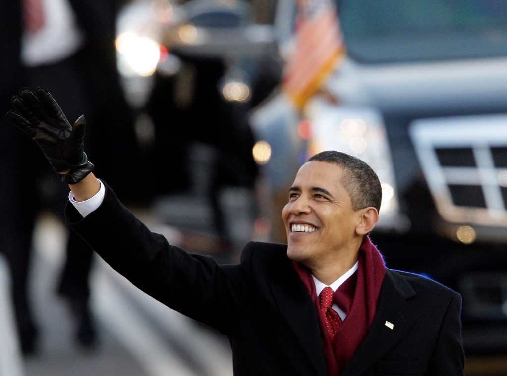 . President Barack Obama waves as he walks down Pennsylvania Avenue on his way to the White House in Washington Tuesday, Jan. 20, 2009. (AP Photo/Alex Brandon)
